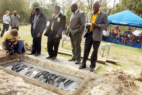 IMAGE: Boy's body exhumed