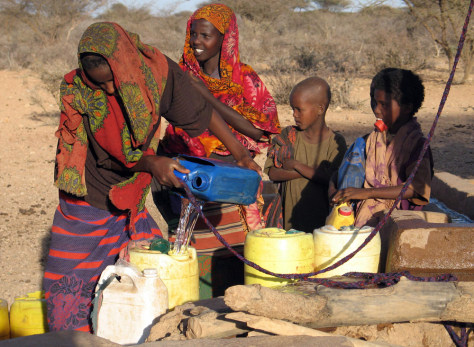 Somali girls collect water at a well in Wajid region in southern Somalia