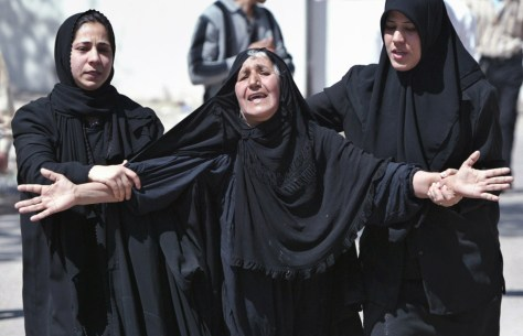 Woman cries outside hospital after relative was killed in suicide car bomb attack in Baghdad