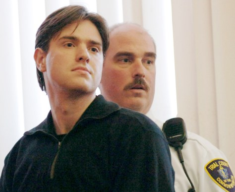 Entwistle of Britain is seen with court officer in Framingham District Court during arraignment in Framingham