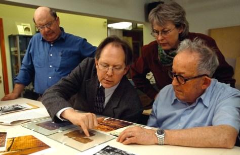 Image: Experts examine manuscript