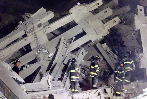 FIREFIGHTERS SEARCH THE REMAINS OF THE WORLD TRADE CENTER