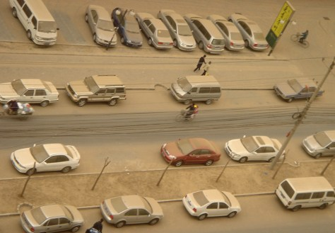 IMAGE: BEIJING CARS COVERED IN SAND