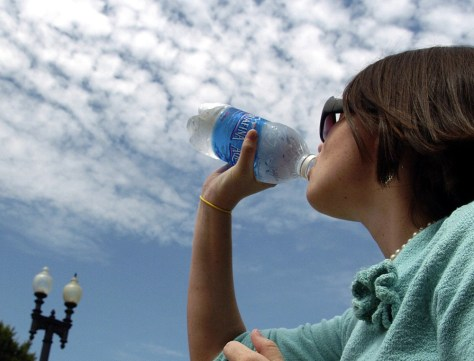 Girl drinks bottle of water