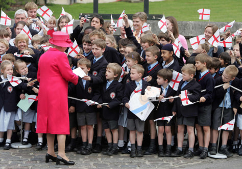 Britain's Queen Elizabeth meets well-wishers outside Windsor Castle in southern England on 80th birthday