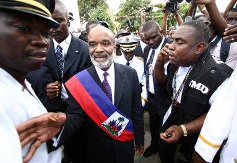 Haiti's new president Rene Preval shakes
