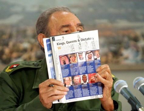 Image: Cuban President Castro displays Forbes magazine.