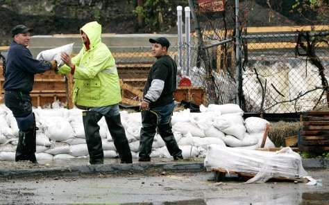 IMAGE: SANDBAGS PLACED ALONG RIVER