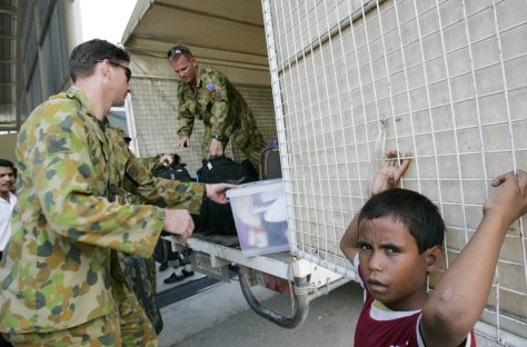 BOY AND AUSTRALIAN TROOPS