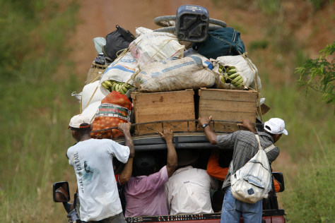 IMAGE: BRAZILIANS WITH BELONGINGS DRIVE INTO NATIONAL PARK