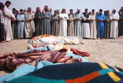 Image: Iraqis pray at funeral