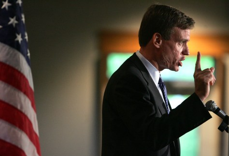 Former Virginia Governor Warner gestures while speaking at the New Hampshire Democratic Party Convention in Goffstown, New Hampshire