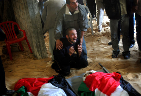 Image: Hamdi Amen next to his slain family