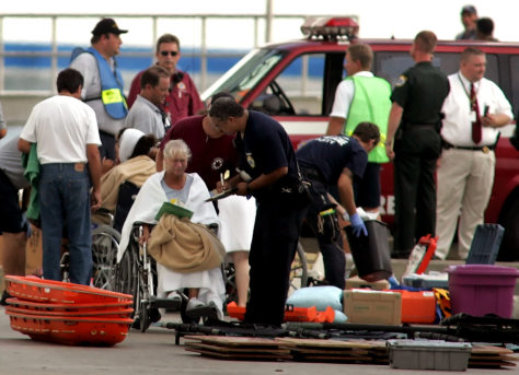 Injured passengers are attended to after being evacuated from the cruise ship Crown Princess in Port Canaveral