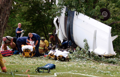 Image: rescue workers at scene of plane crash