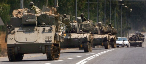 Israeli military vehicles move on road near northern city of Kiryat Shmona toward Israeli-Lebanese border
