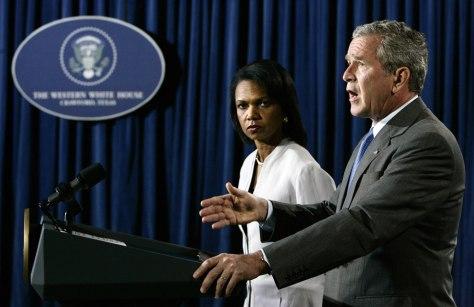 U.S. President Bush speaks alongside Secretary of State Rice in Crawford