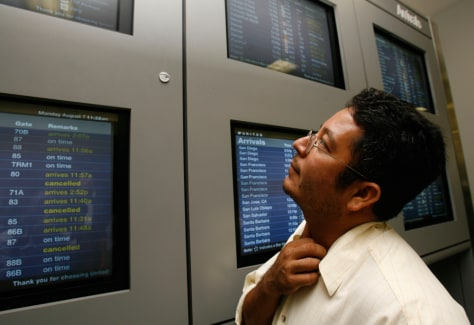 Image: Passenger scans LAX monitors