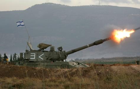 Image: Israeli tank fires at Hezbollah