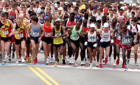 Men elite runners take off from the starting line of the Boston Marathon in Hopkinton, Massachusetts