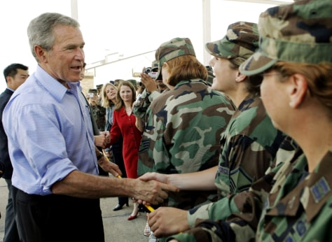 IMAGE: President Bush greets military personnel