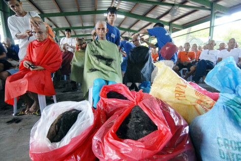 IMAGE: INMATES AND BAGS OF HAIR