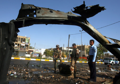 Image: Car bomb wreckage in Baghdad