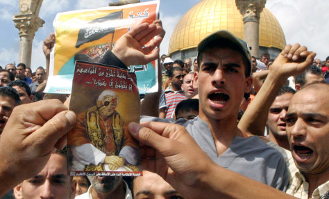 Palestinian Muslims hold up portraits during demonstration against Pope Benedict's remarks in Jerusalem