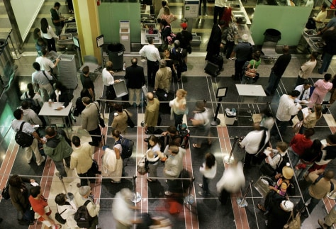 IMAGE: TRAVELERS IN AIRPORT SECURITY LINE