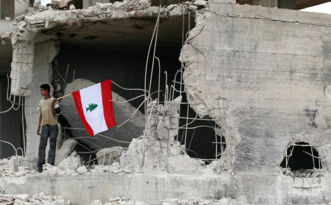 Image: Lebanese villager waves a flag