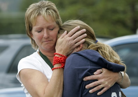 Image: Mother hugs student