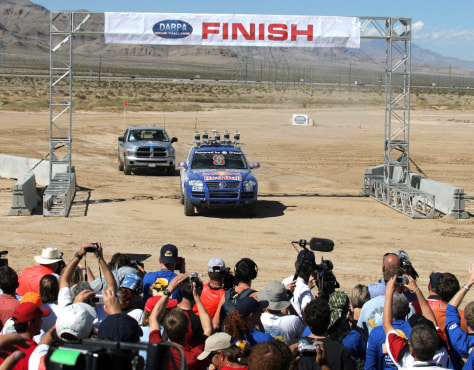 Image: Stanford University Racing team crosses DARPA 2005 Challenge Race finish line in Primm