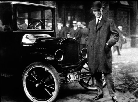 IMAGE: Henry Ford with a Model T