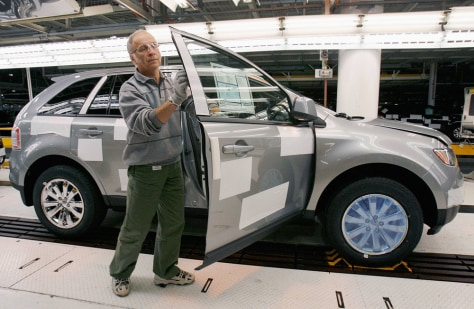 Image: Ford employee inspects new Ford Edge