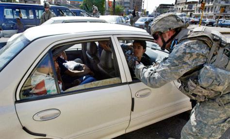 IMAGE: U.S. soldier checks car in Baghdad