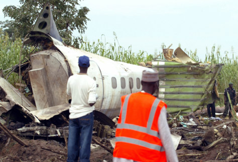 Emergency and Red Cross workers are seen at crash site of an ADC Airlines plane in Abuja, Nigeria