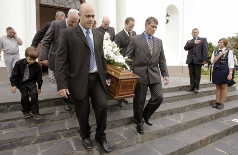 Pallbearers carry the coffin of former South African President P.W. Botha at his funeral in George