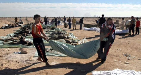 Image: Iraqi bodies carried to funeral
