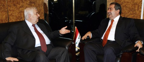 Syrian Foreign Minister Walid Moallem (L) and Iraqi Foreign Minister Hoshyar Zebari