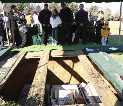 Fathers Valdez and Lopez grieve in Osceola, Indiana during funeral services for their children