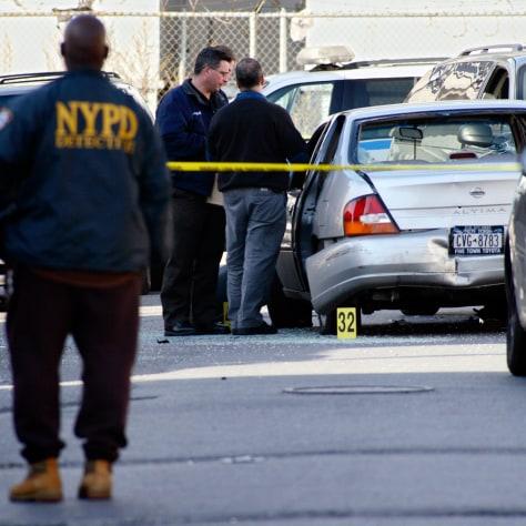 IMAGE: Investigators inspect car