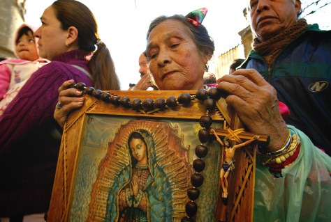 IMAGE: Woman with image of the Virgin of Guadalupe