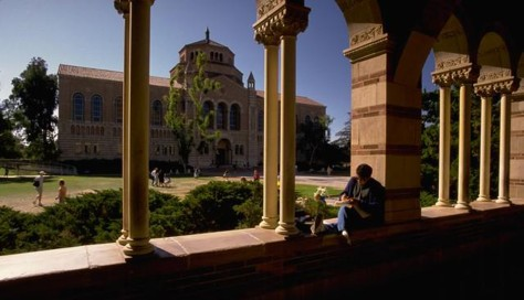 Student Sits Under Arches at Royce Hall