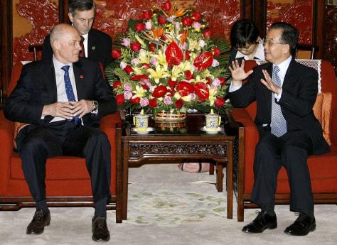 IMAGE: Henry Paulson and Wen Jiabao.