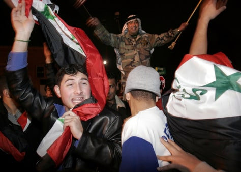 Image: Arab Americans celebrate Saddam Hussein's impending execution
