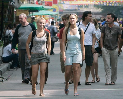 Tourists walks along Khao San road in Bangkok