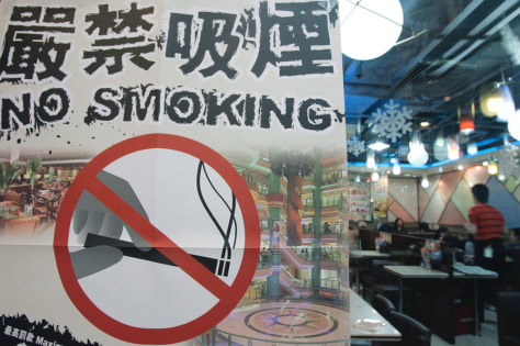 A poster promoting the new anti-smoking law is shown at a restaurant in Hong Kong