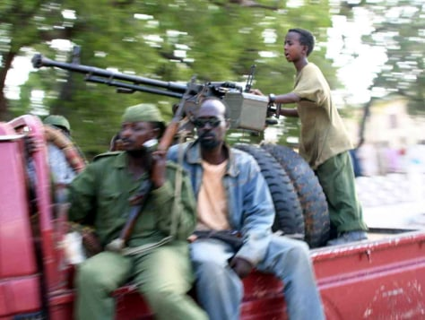 IMAGE: SOMALI BOY WITH ETHIOPIAN SOLDIERS