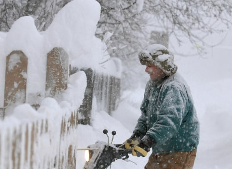 IMAGE: ANCHORAGE RESIDENT REMOVES SNOW