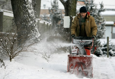 IMAGE: MAN USES SNOW BLOWER